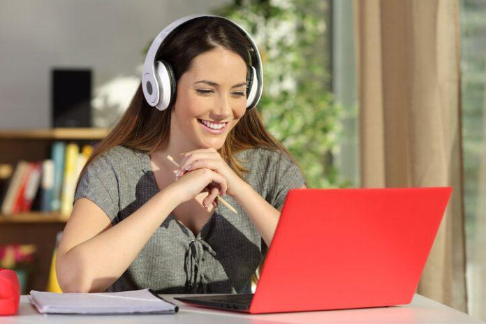 Student Watching Video Tutorials On Line